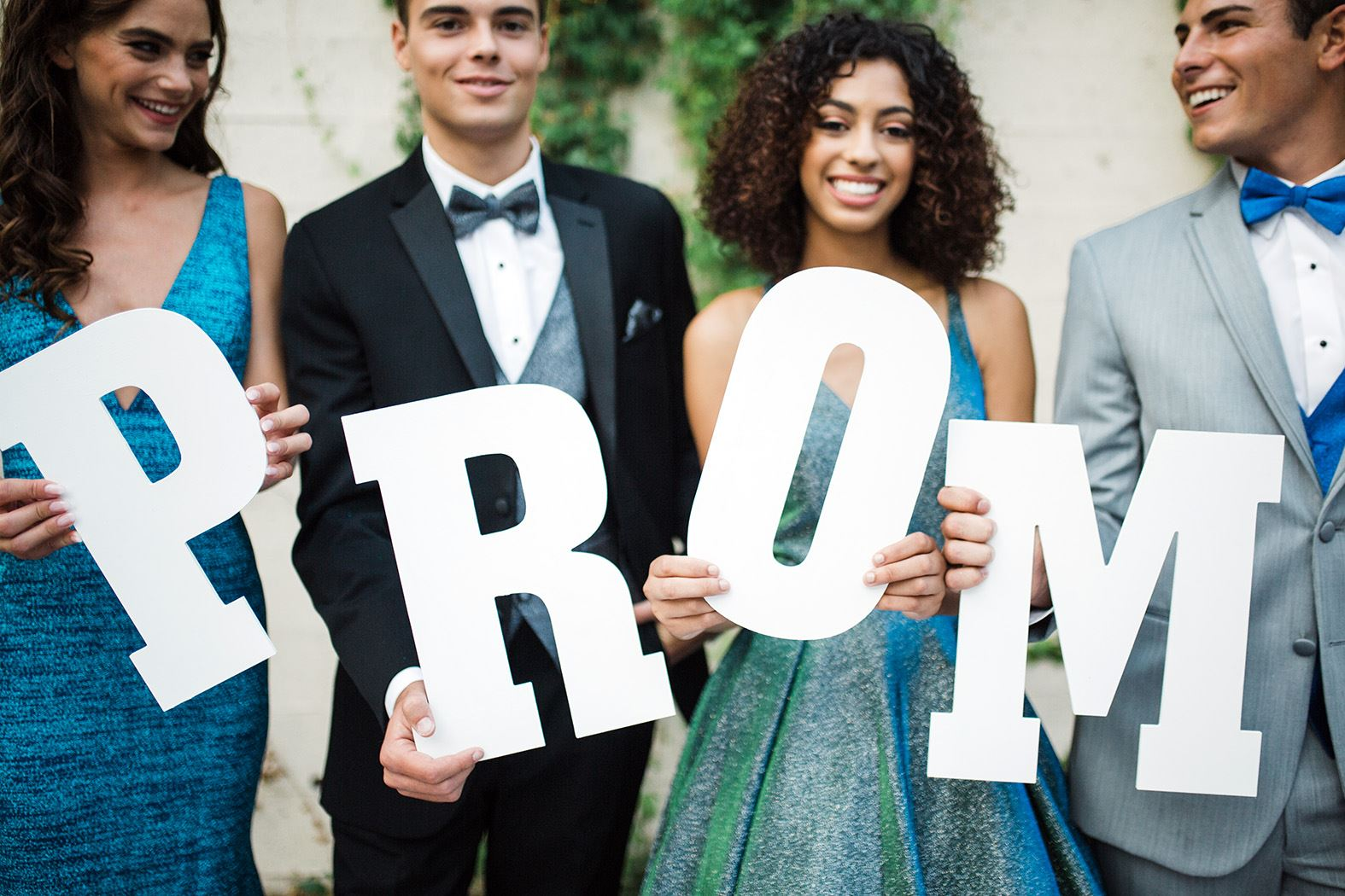 Models holding prom letters